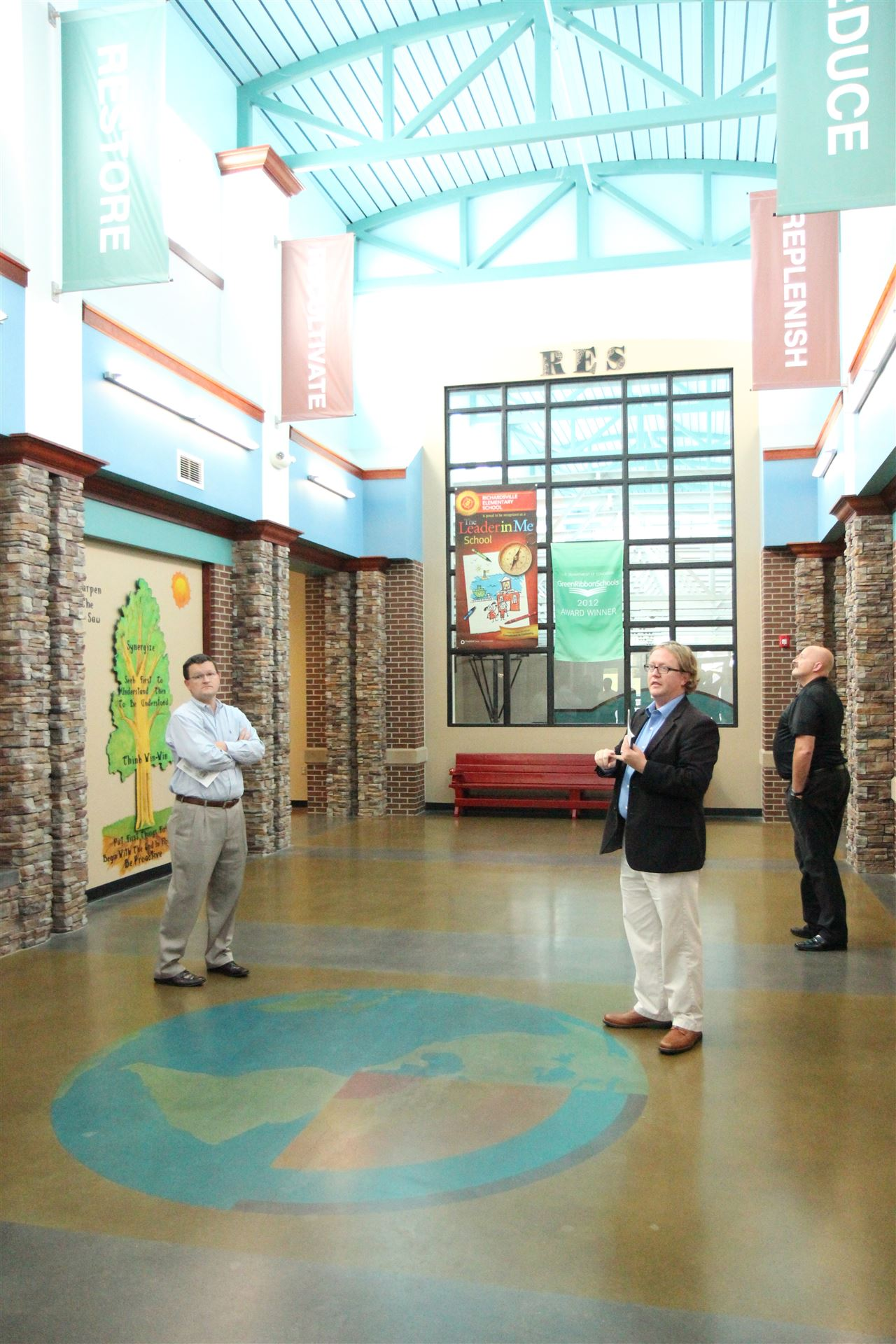 "Professionals in education, government and industry from West Virginia, Ohio and North Carolina toured Richardsville Elementary October 9 to learn about thew design elements that have made it the nation's first ""Net Zero"" school building."