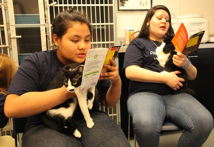 English Learners improve reading skills by reading to animals.