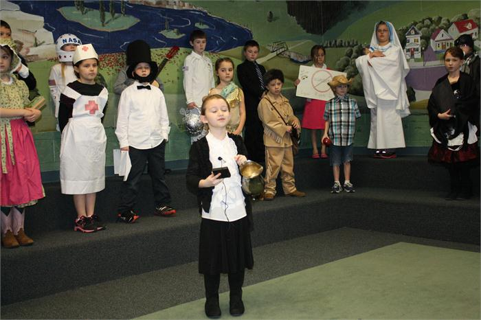 Second graders dressed as historical figures and made presentations.