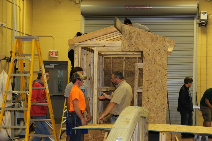 Students working on building a storage building.