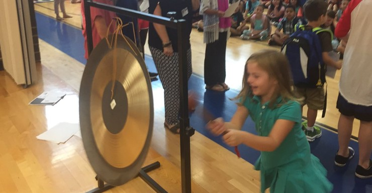 Celebrating academic growth with our Celebratory Gong!