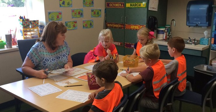 Mrs. Tina helping our new learners.