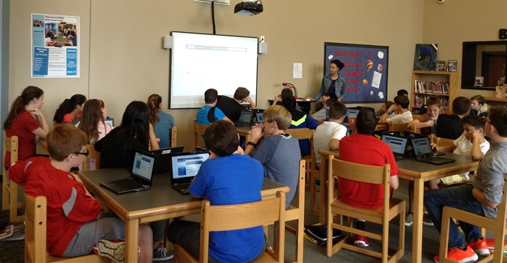 8th grade students work with WCPL online authoritative and educational resources