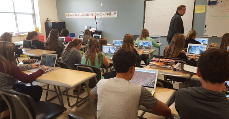 Students virtually explore the Eiffel Tower  through an interactive tour in Mr. Spinks' classroom