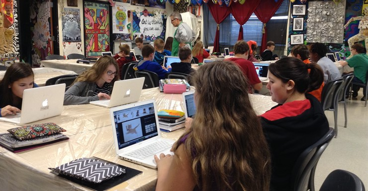 Spartans learn how to manipulate photos for mythology projects in Mr. Johnson's art class