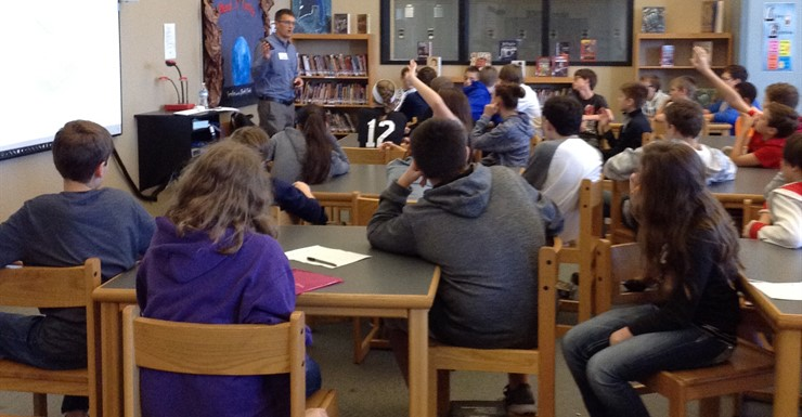 Engineer, Derek Clemons, speaks with students about careers in manufacturing & engineering