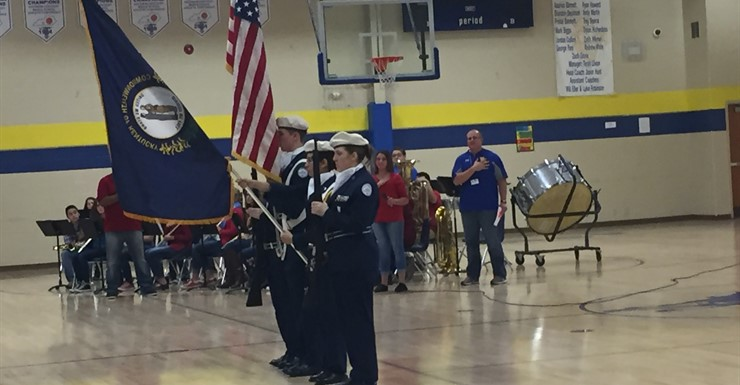 WEHS JROTC Presents the colors for the National Anthem at the Veterans Day Assembly.