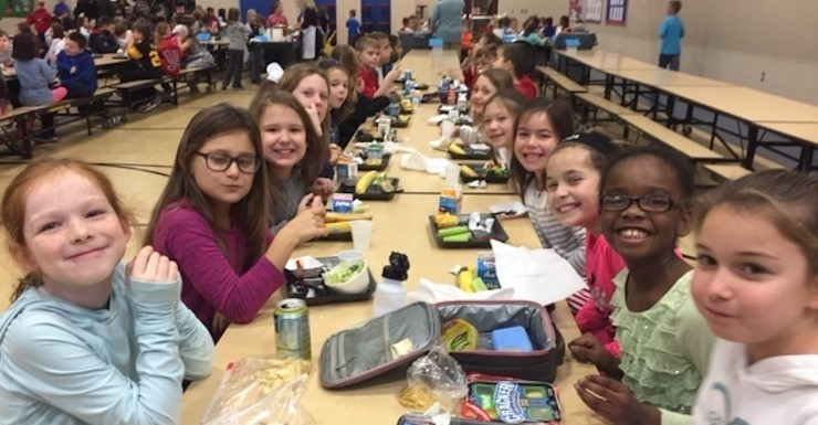 3rd grade enjoying lunch in our dining room