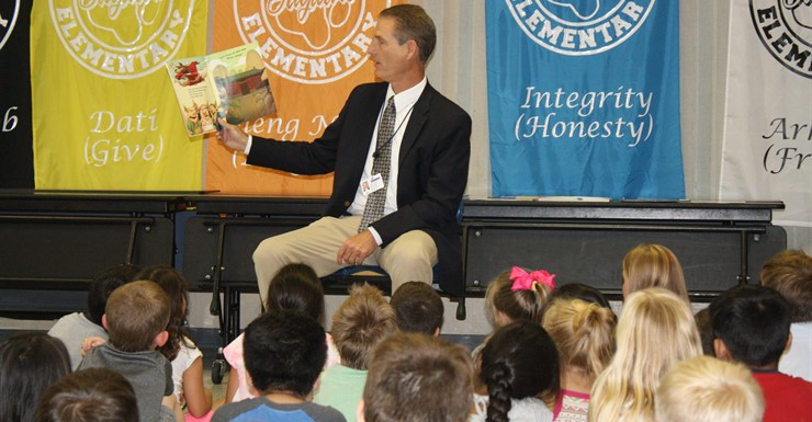 Superintendent Clayton reads to students at the Summer Literacy Academy