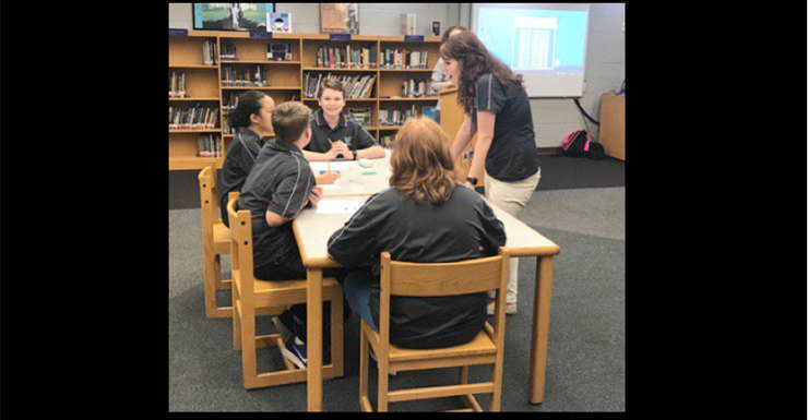 SWMS Quick Recall team talks strategy with Coach Heming.