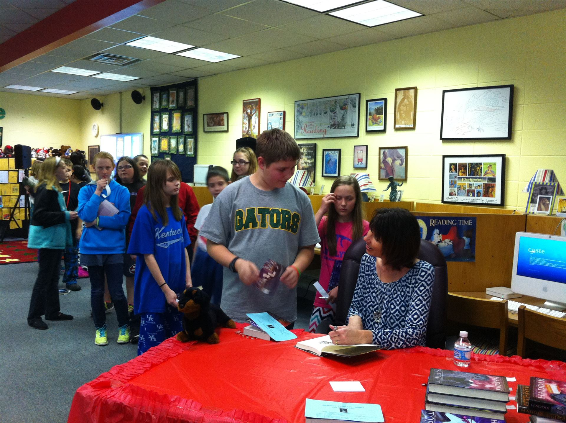 Mrs. Haddix Signs Students Books!