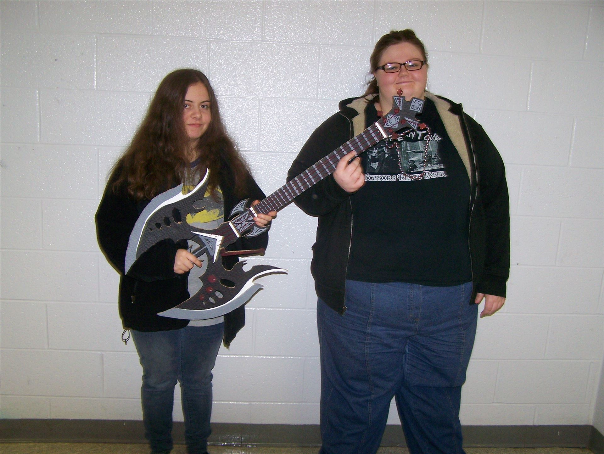 Shelby Brindley and Gayle Taylor show their guitar.