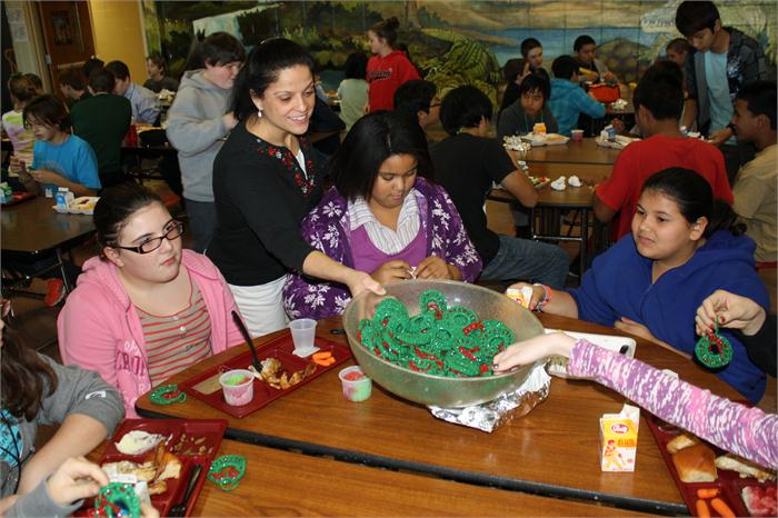 DCMS food service worker crochets holiday wreaths for students